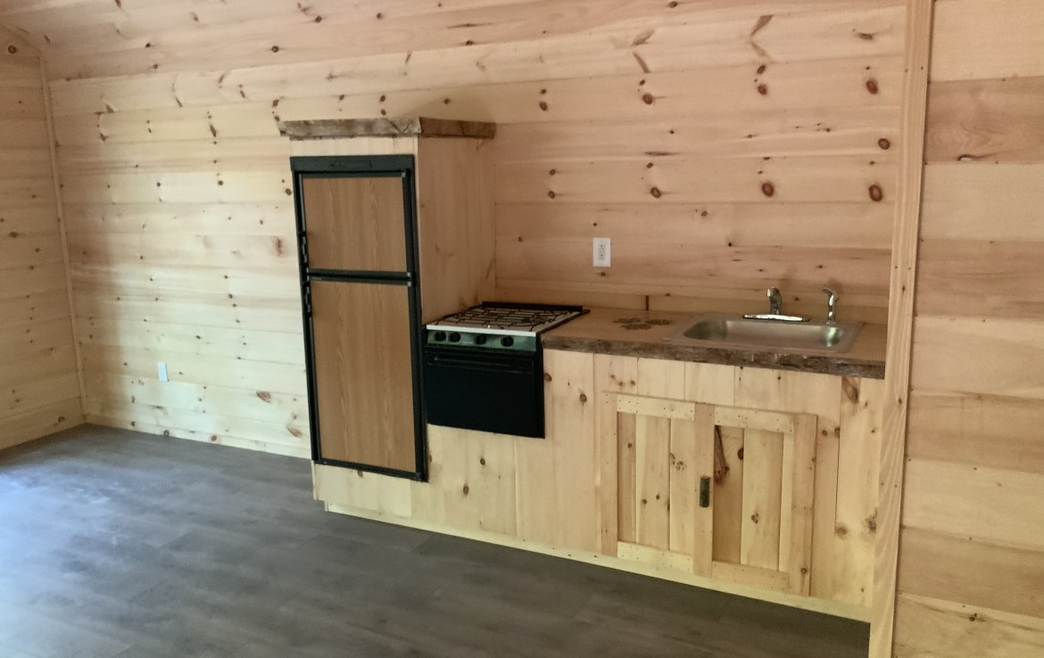 Propane refrigerator and kitchen area with LP stove for cooking!
