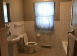 Off of the living room is a Full Bathroom